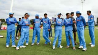India Under-19 cricket team seen cheering for India hockey team
