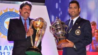 Kapil Dev, MS Dhoni exchange world cup trophies during BCCI Annual Awards