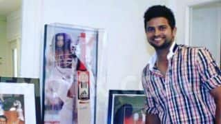 PHOTO: Suresh Raina poses with Sachin Tendulkar's bat