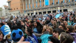 FIFA World Cup 2014: Violence mars celebrations of Uruguay's win over Italy in Montevideo