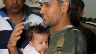 Photo: MS Dhoni and daughter Ziva at Ranchi airport