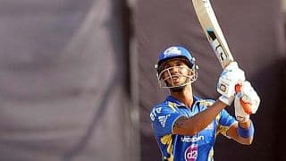 Simmons, Chand take Mumbai Indians forward against Royal Challengers Bangalore in Match 16 of IPL 2015
