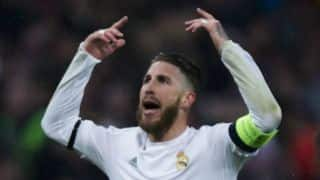 UEFA Champions League 2015-16 final: Sergio Ramos celebrates with cup at Madrid's Cibeles Square