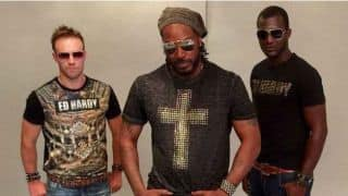 AB de Villiers, Chris Gayle, Darren Sammy of Royal Challengers Bangalore pose during IPL