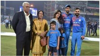 Virat Kohli, Shikhar Dhawan take blessings from Ashish Nehra's parents