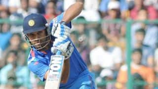 Dhawan, Rohit accelerate after slow start