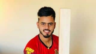 Virat Kohli presents Nitish Rana with a bat after latter's surprise bowling performance against RCB