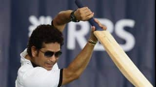 Sachin Tendulkar walks out to bat in Lord's bicentenary match