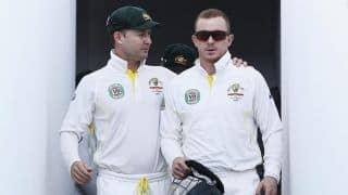 Michael Clarke adopts new helmet following Chris Rogers dizziness bout