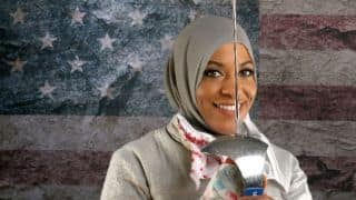 US Olympian fencer Ibtihaj Muhammad asked to take out her hijab for photo on her ID badge