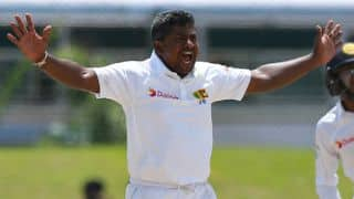 Rangana Herath goes past Daniel Vettori during Sri Lanka vs Bangladesh, 1st Test