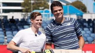 Smith plays tennis with Milos Raonic