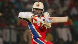 Chris Gayle dismissed by Praveen Kumar for 21 during Royal Challengers Bangalore-Sunrisers Hyderabad IPL 2015 match