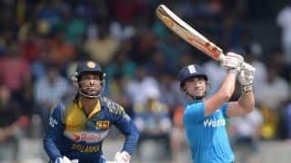 James Taylor, Eoin Morgan guide England to 265